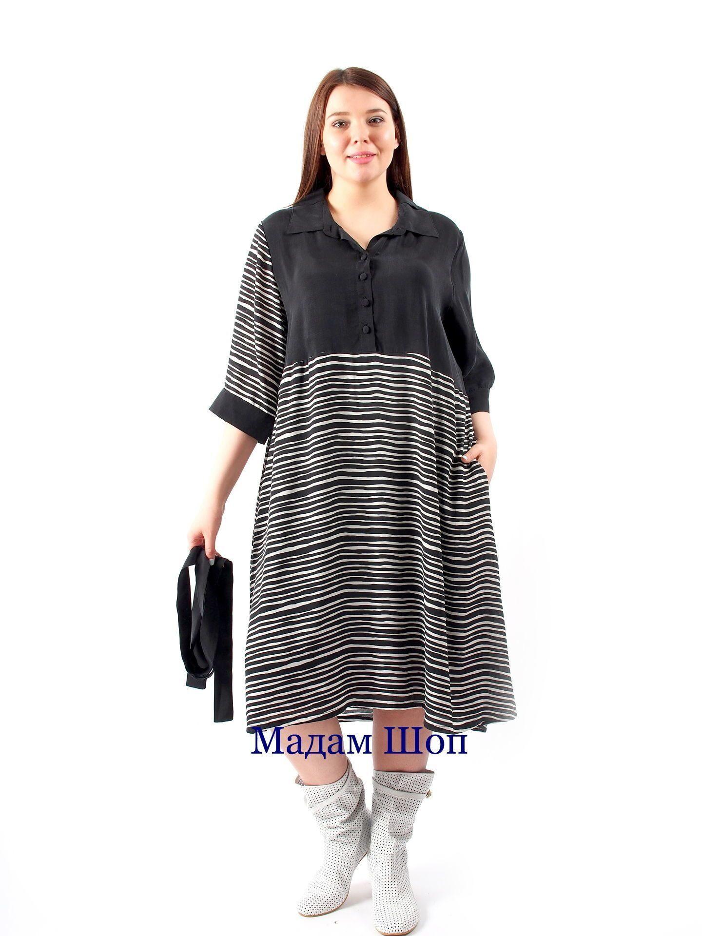 8c9f8d0a9f7 Модное черно-белое платье с галстуком выполнено из комбинированной ткани.  Верх и один из