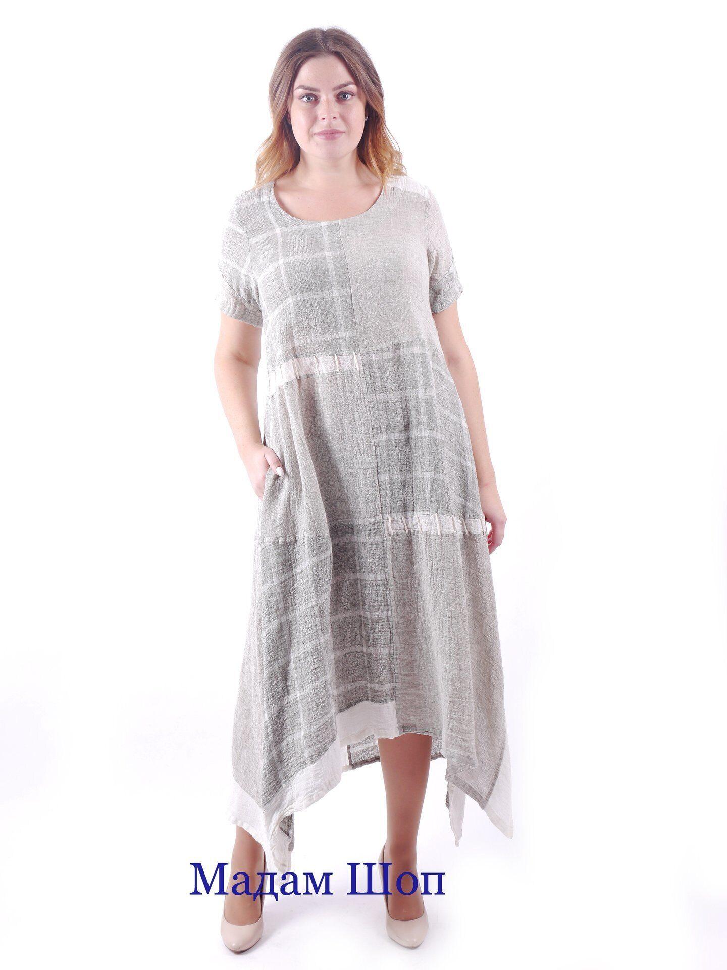 e8e14e4689a Летнее льняное платье с карманами и асимметричным подлом. По подолу  отделано белой оборкой